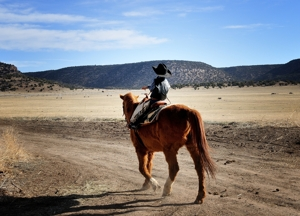 "Kade Brown as ""John Wayne"" horseback at Brown Ranch branding 2012"