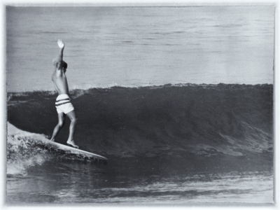 Tim Keller surfiing at Santa Monica, 1965