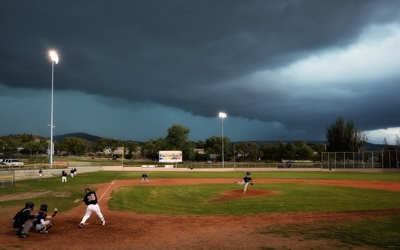 Raton Osos under a storm at Gabriele Field