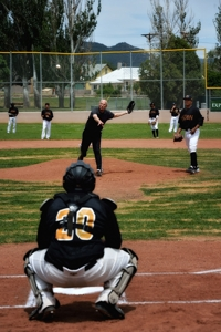 Butch McGowen throws first pitch at Raton Osos game, 2014