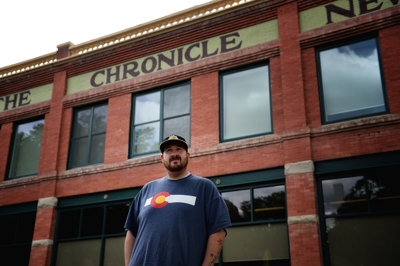 Adam Sperandio at The Chronicle-News, portrait by Tim Keller
