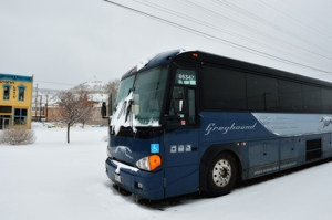 Greyhound bus waits in snow at Raton, New Mexico