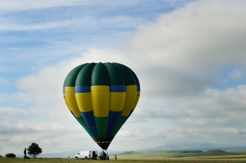 Lone hot-air balloon against Raton New Mexico landscape