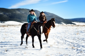 Sisters Jana Mills and Ashlee Rose Mills at home on horseback in Eagle Nest, New Mexico, January 2016