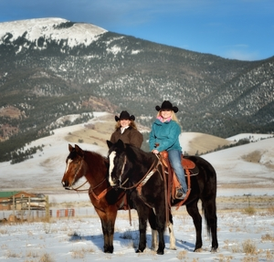 Jana Mills and Ashlee Rose Mills at home on horseback in Eagle Nest, New Mexico