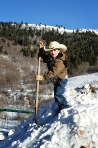 Chance Walton shoveling snow at Sugarite Canyon Ranch