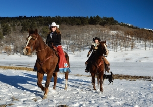 Anne Sporleder & Micheli Walton horseback at Sugarite Canyon Ranch, Dec 2015