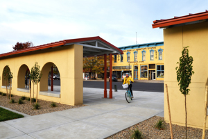 Bicyclist at sunrise, depot at Raton, New Mexico, by Tim Keller