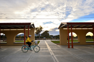 Bicyclist at Raton Depot Multi-Modal Center at Sunrise, by Tim Keller