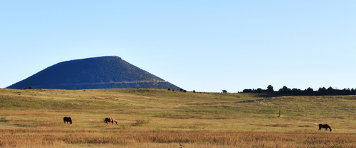 Capulin Volcano and horses grazing, by Tim Keller