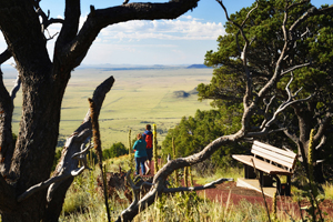 Capulin Volcano National Monument - hikers along the rim trail, by Tim Keller