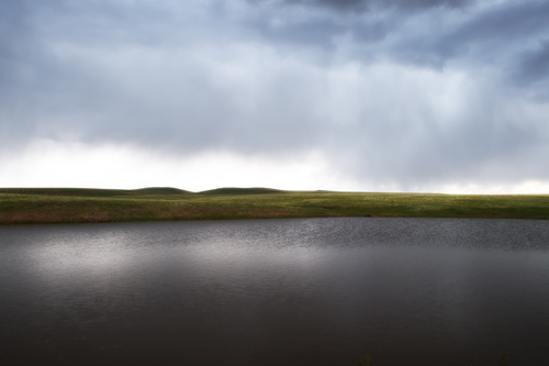 Johnson Mesa stock pond in thunderstorm