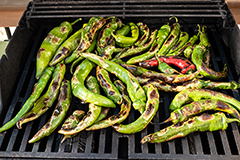 New Mexico green chile roasting on the grill