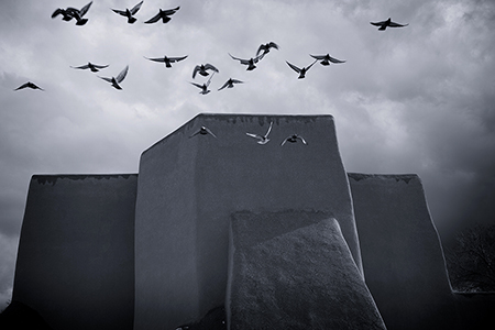 Birds take flight at San Francisco de Asis Mission Church, Ranchos de Taos, NM, by Tim Keller
