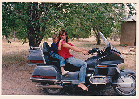 Darcy Day Keller and Tim Keller on Tom Noe's motorcycle, Serafina, NM 1989