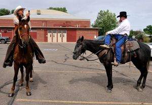 cell phones horseback, Swink Colorado parade