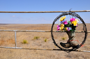 Cowboy wreath on ranch gate
